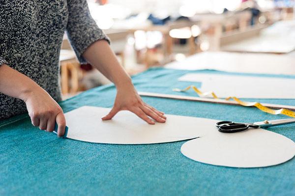 A fashion designer creating a clothing pattern